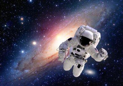 Affisch Astronaut spaceman kostym rymden solsystem människor universum. Delar av denna bild som tillhandahålls av NASA.