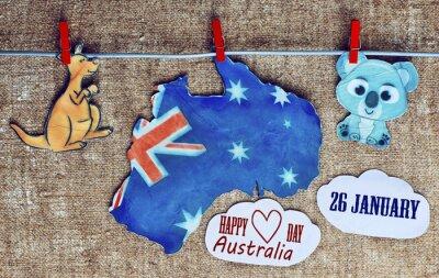 Affisch Australien dag Concept - hälsning skrivet över vita australiska kartor, kängurur och koala - hängande pinnar (klädnypa), 26 januari. tonad bild. solljus effekt