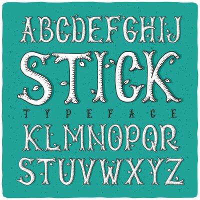 Affisch Grafisk hand typ gjord av stiliserade träpinnar. Vit på grön bakgrund.