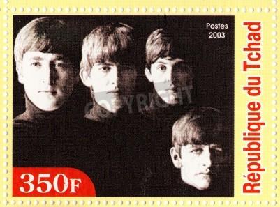 Affisch GUINEA - cirka 2003: The Beatles - 1980 berömda musikalisk popgrupp.