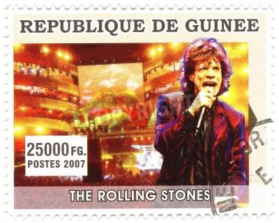 Affisch GUINEA - cirka 2007 berömda rocksångare Mick Jagger från musikband av Rolling Stones