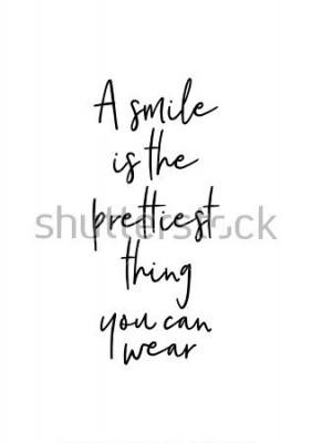Affisch Handtecknad bokstäver. Bläckillustration. Modern pensel kalligrafi. Isolerad på vit bakgrund. Ett leende är det vackraste du kan bära.