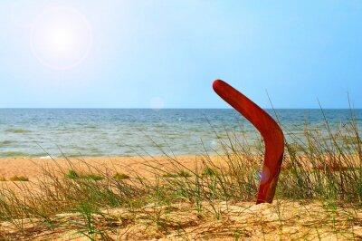Affisch Landskap med bumerang på vuxen sandstrand.