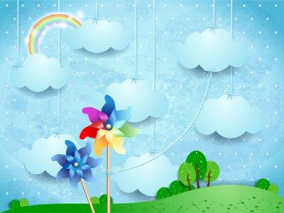 Affisch Overkligt landskap med pinwheels och hängande moln