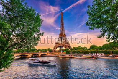 Affisch Paris Eiffel Tower and river Seine at sunset in Paris, France. Eiffel Tower is one of the most iconic landmarks of Paris.