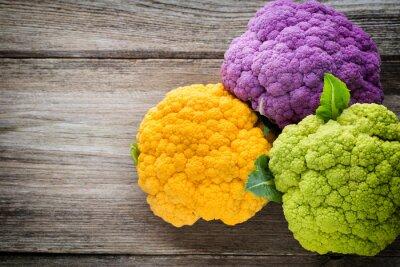 Affisch Regnbåge miljö blomkål på träbordet.
