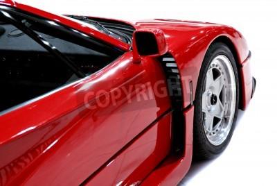 Affisch Sidan och främre änden av en röd sportbil