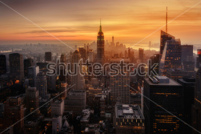 Affisch View of New York City from the top of one of its viewpoints, capturing the warm light of sunset