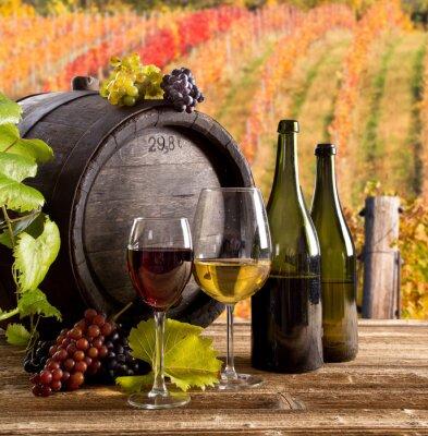 Affisch Vin stilleben, glas, unga vinstockar och vindruvor
