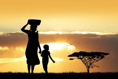 Canvastavlor Afrikansk kvinna och son vid solnedgången