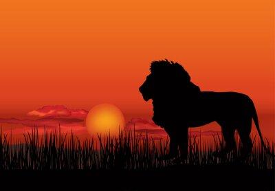 Canvastavlor Afrikanska landskapet med djur lejon silhuett. Savann solnedgång bakgrunden