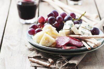 Canvastavlor Antipasto med ost, korv och druv