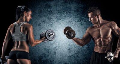 Canvastavlor Atletisk man och kvinna med hantlar.