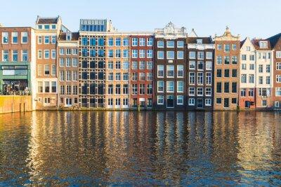 Canvastavlor Byggnader längs Damrak under dagen i Amsterdam