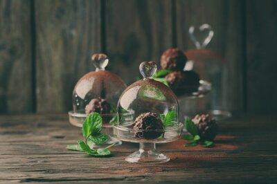 Canvastavlor Choklad godis med nötter, mynta och kakao på vintage bordet
