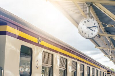 Canvastavlor Classic urban analog clock in train station terminal. Concept photo of time, appointment, deadline, meeting, business, travel and schedule..