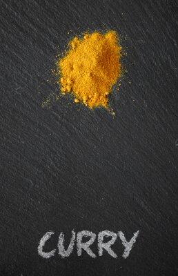 Canvastavlor Curry på en svart skiffer bord