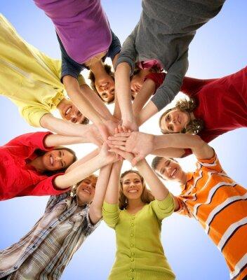 Canvastavlor En grupp lyckliga ungdomar som håller ihop händerna
