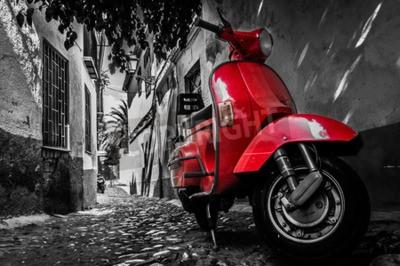 Canvastavlor En röd vespa scooter parkerade på en asfalterad gata