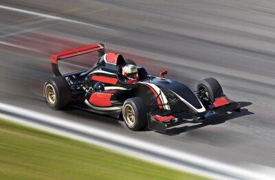 Canvastavlor F1 bilspel på en bana med rörelseoskärpa