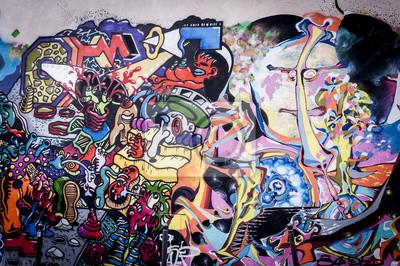 Canvastavlor Fond Mur de graffitis aux couleurs vives