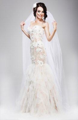 Canvastavlor Förväntan. Vackra Jubilant brud i vit brudklänning