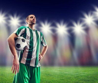 Canvastavlor Fotboll-spelare med en boll