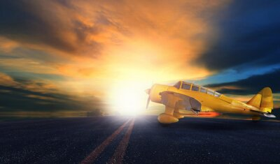 Canvastavlor gamla gula propellerplan på flygplatsens landningsbana med solnedgång sky bac