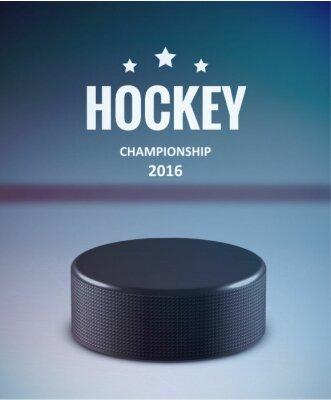 Canvastavlor Hockey puck isolerat på is med oskärpa