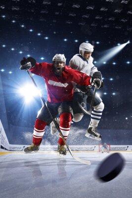 Canvastavlor Hockeyspelare skjuter pucken och attacker