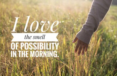Canvastavlor Inspirational motivational quote - I love the smell of possibility in the morning. With warm morning light over the field & young woman hand touch the leaves of paddy in field background.