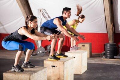 Canvastavlor Jumping övningar på ett gym