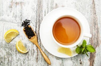 Canvastavlor Kopp te med citron och mynta