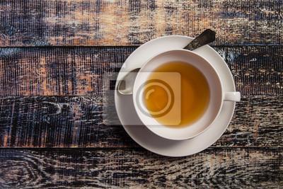 Canvastavlor Kopp te på trä bakgrund
