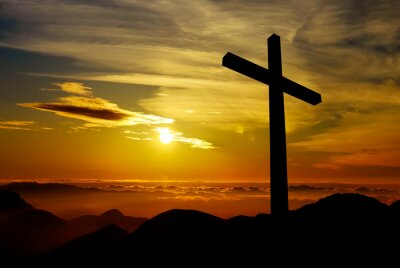 Canvastavlor Kristet kors på solnedgången bakgrund