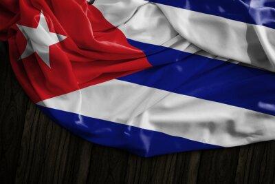 Canvastavlor Kubansk flagga på träbord