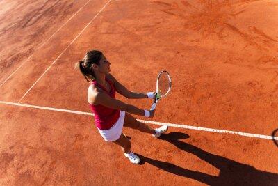 Canvastavlor Kvinnlig tennisspelare som betjänar en tennisboll