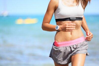 Canvastavlor Löpare kvinna med pulsmätare igång
