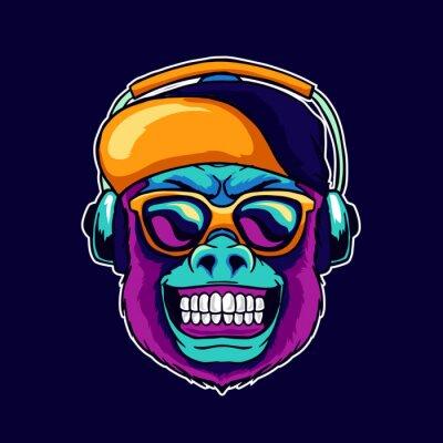 Canvastavlor Monkey smile wear cool glasses and cap hat listening dope music on the headphone speaker vector illustration. Pop art color style animal gorilla head logo design for creative DJ sound producer studio.