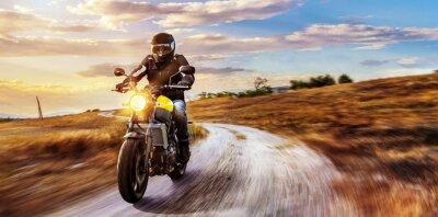 Canvastavlor Motorrad fährt auf Freier Landstrasse i den Sonnen