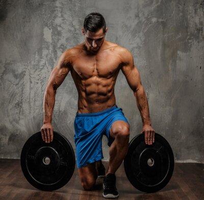 Canvastavlor Muskulös kille i blå shorts
