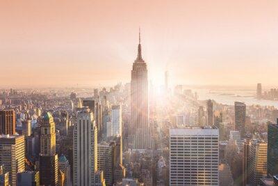 Canvastavlor New York Manhattans skyline i solnedgången.