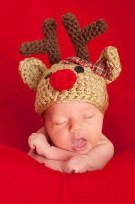 Canvastavlor Nyfött barn har en röd mulen Hat