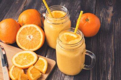 Canvastavlor Orange frukt smoothie i glasburkar