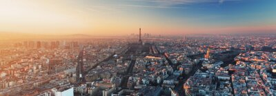 Canvastavlor Panorama över Paris på solnedgången