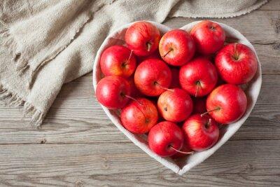 Canvastavlor Röda äpplen på ett bord