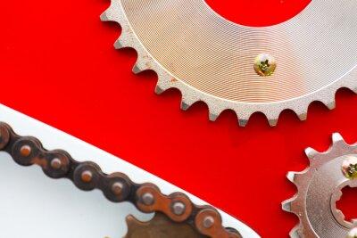 Canvastavlor Rullkedjor med kedjehjul för motorcyklar på röd bakgrund
