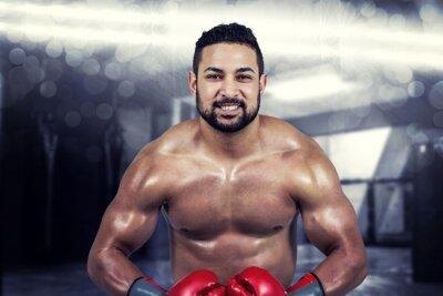 Canvastavlor Sammansatt bild av muskulös man boxning i handskar
