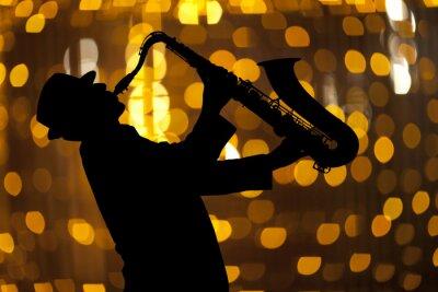 Canvastavlor Saxofonist. Man spelar på saxofon
