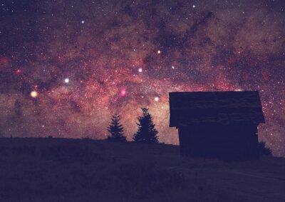 Canvastavlor Silhuetter av en landsbygd med Vintergatan. Lång exponering foto taget från en mörk bergstopp.
